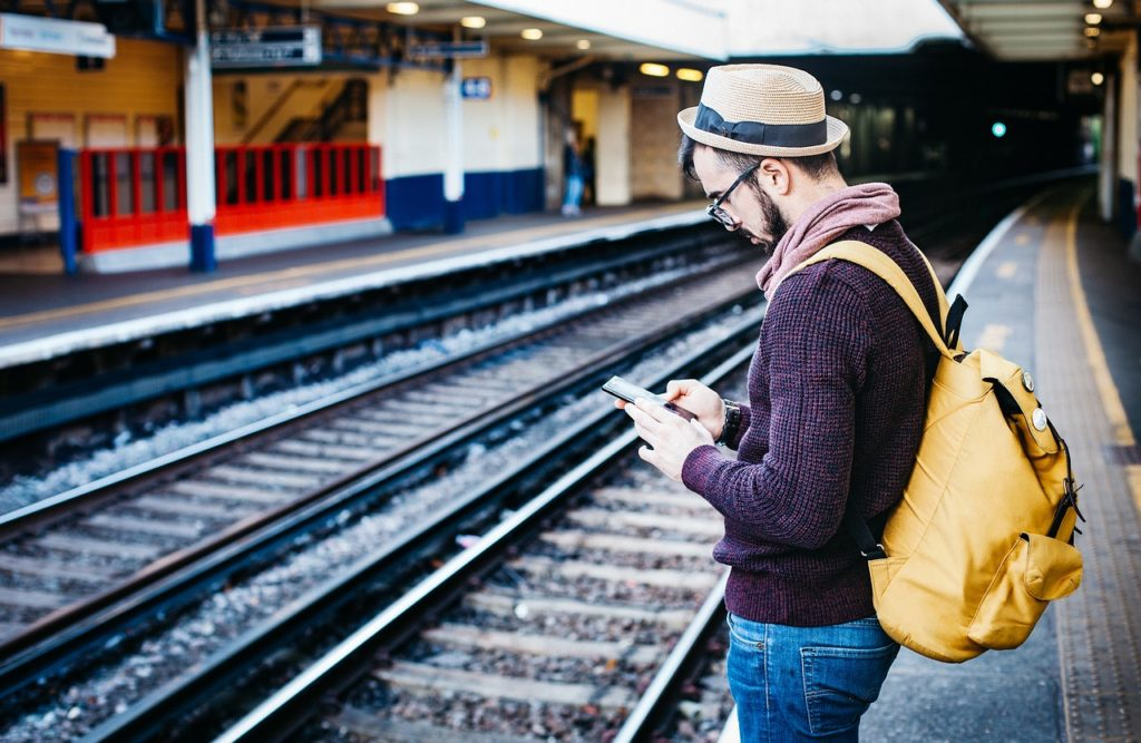 Man at station with app